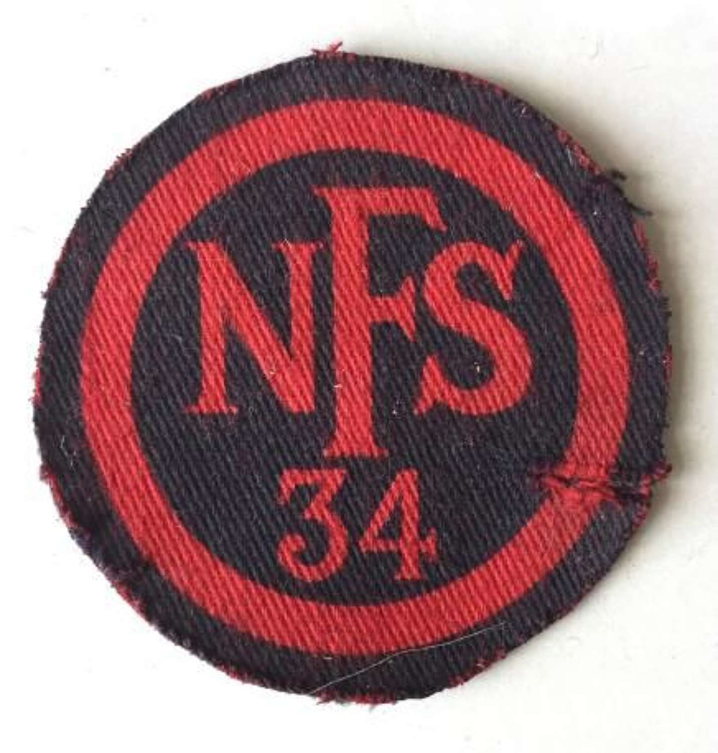 Original WW2 Printed NFS 34 Breast Badge
