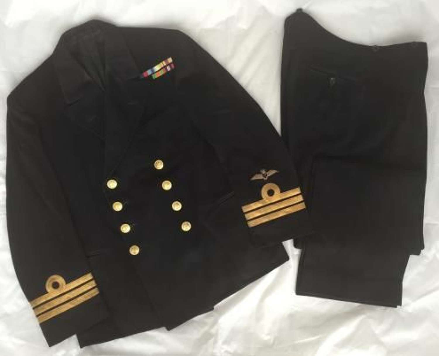 1943 dated Fleet Air Arm Swordfish Pilots tunic and trousers names to Cdr A. C. R. Duvall